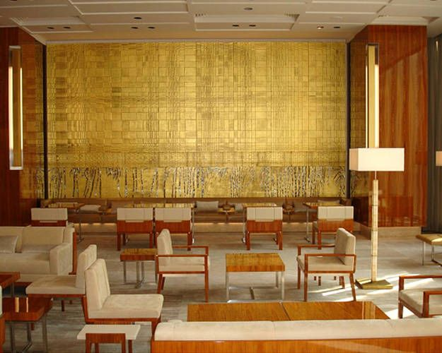"""""""There is a perfect tension between the ceremonial nature of the gold and the earthiness of the wood that really makes this room come alive."""""""