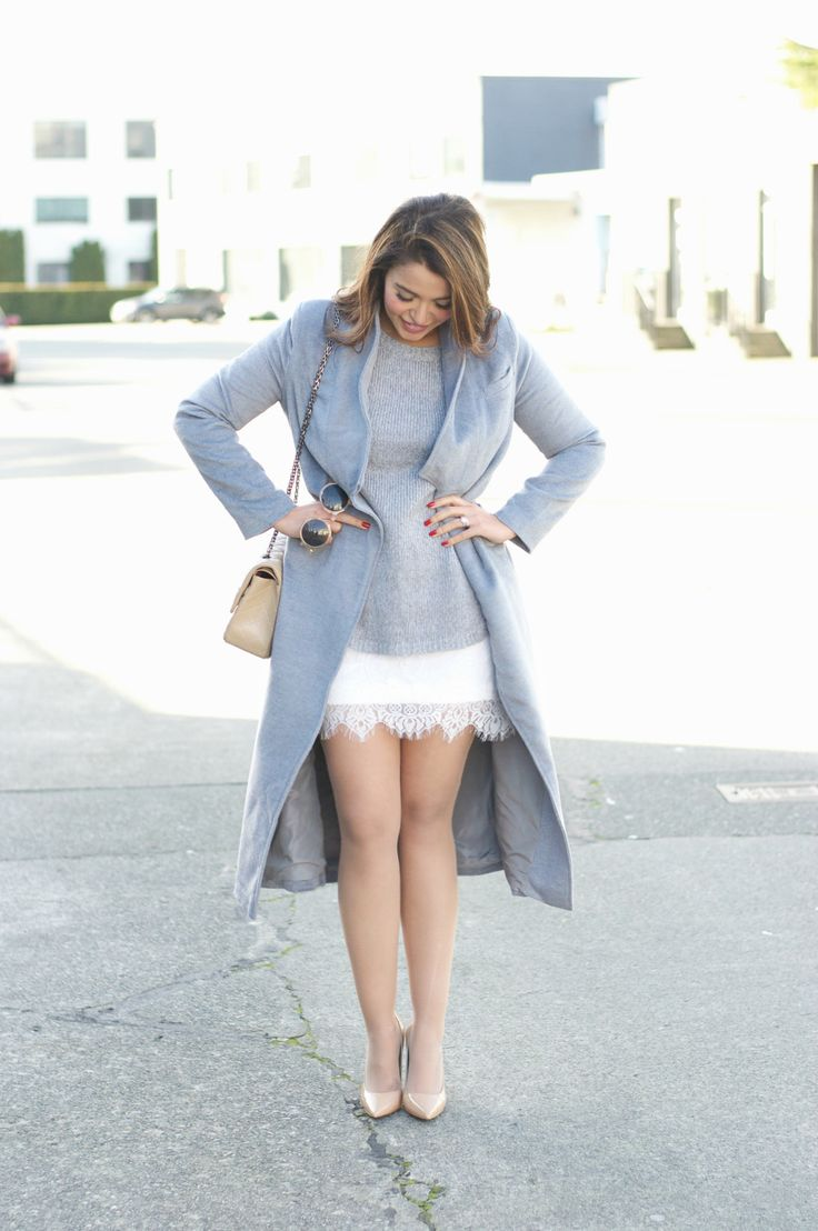 everything about this outfit - grey sweater worn over white lace dress with nude tights, nude heels and a long grey coat