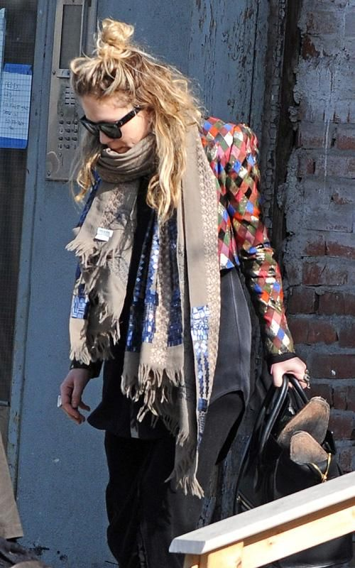 MK in layers and a messy topknot.