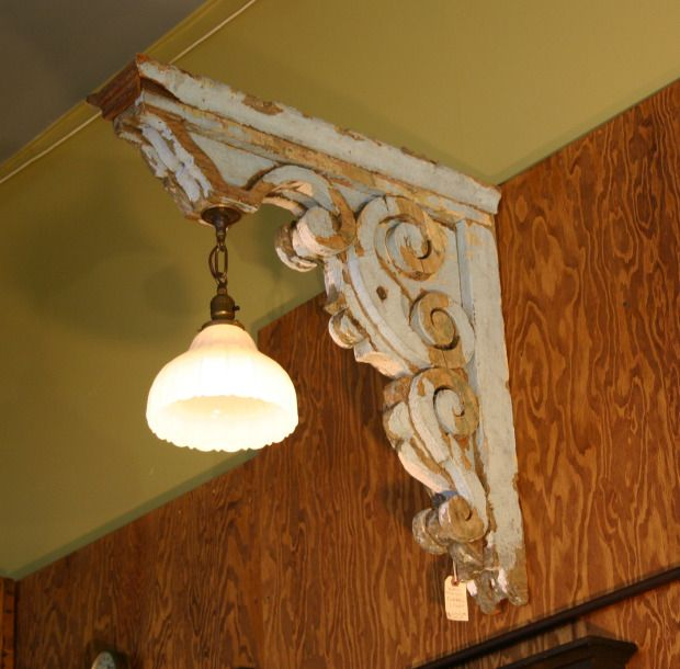 Use a corbel to add some flair to light fixtures!