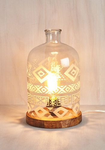 Update the look of your home with this unique lamp! A wooden base welcomes the light bulb of your choice and is topped with a glass dome that's etched to southwestern-inspired perfection. Let there be 'delight'!