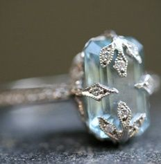 The clamps are gorgeous; and the ice blue shade of the stone makes our knees weak. #engagementring