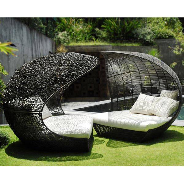 Generally I hate wicker furniture, but I'd be down with these chairs. Definitely get some vines to grow up the backs of them!