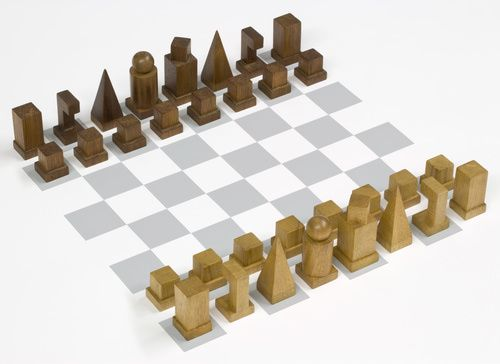 Josef Hartwig (German, 1880-1956). Chess set (model I), 1922. 32 pieces, wood and felt. Smallest: 1 1/16 x 7/8 x 7/8 in. (2.7 x 2.3 x 2.3 cm), Largest: 2 7/16 x 1 1/16 x 1 1/16 in. (6.2 x 2.7 x 2.7 cm). Gift of Julia Feininger.