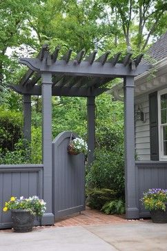 Entrance from driveway to back yard - would be beautiful with a clematis or climbing rose