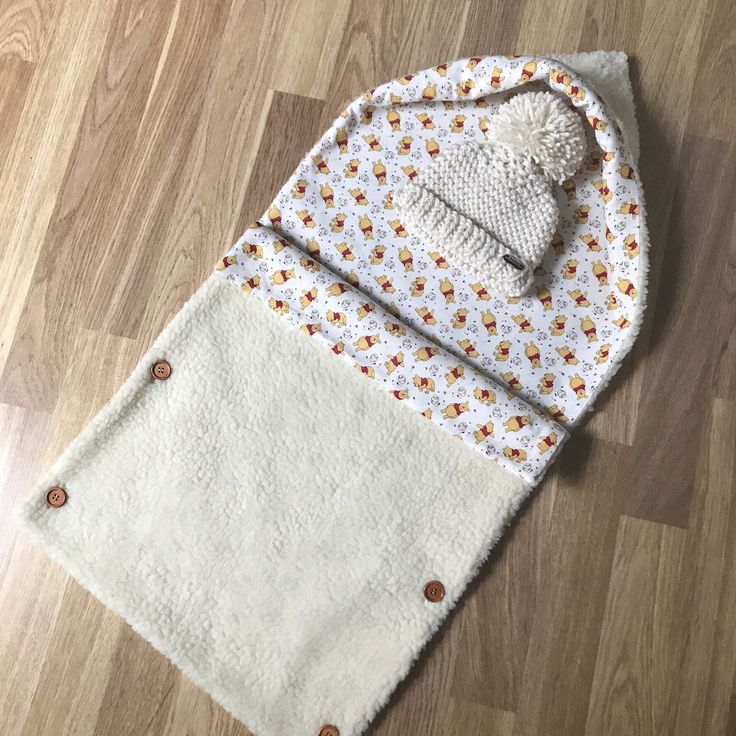 A personal favourite from my Etsy shop https://www.etsy.com/uk/listing/525320075/newborn-baby-sleeping-bag-and-pompom-hat