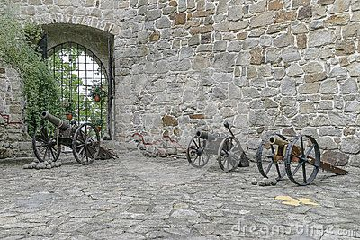 Old cannons on the courtyard in medieval castle Tropsztyn. Poland
