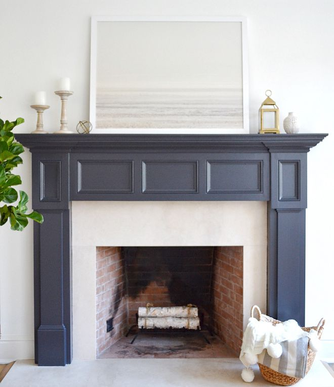 The fireplace paint color is Benjamin Moore Midnight Oil. Art is Patagonian Winter print from Minted.  #fireplaces