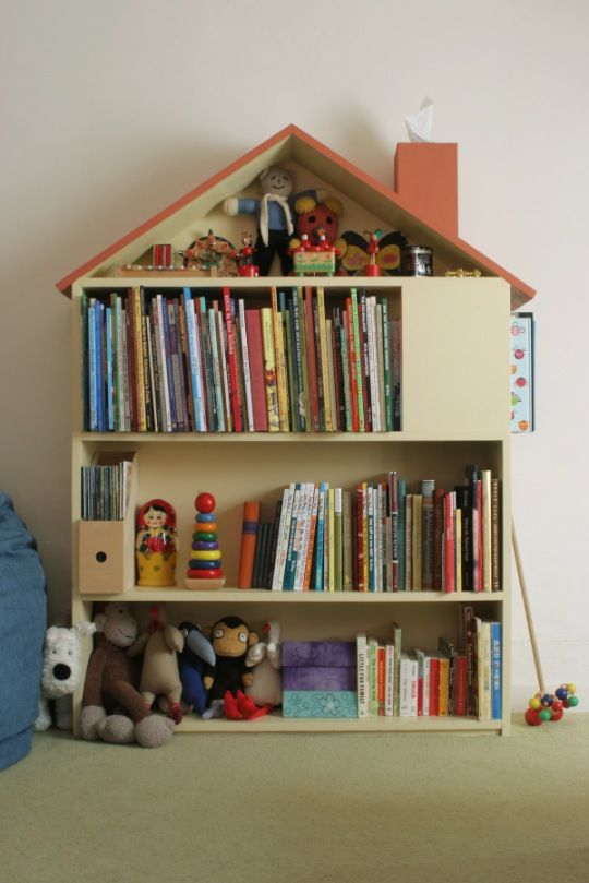 OH MY GOD! YES I gotta build this one asap... I suppose I can get some cheap bookcase from IKEA and build my own roof with a little chimney that actually houses a tissue box. Kind of cute... not positive if I like it enough.