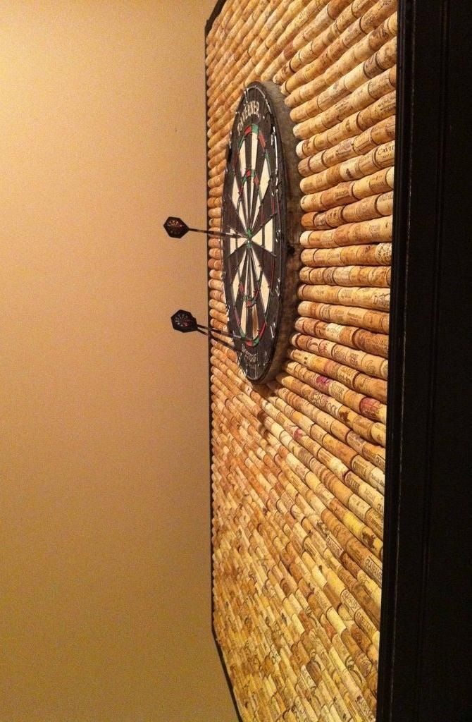 Protect Your Wall From Stray Darts With This Diy Dartboard Cabinet Made Of Wine Corks Wine Cork Crafts Wine Cork Cork Crafts