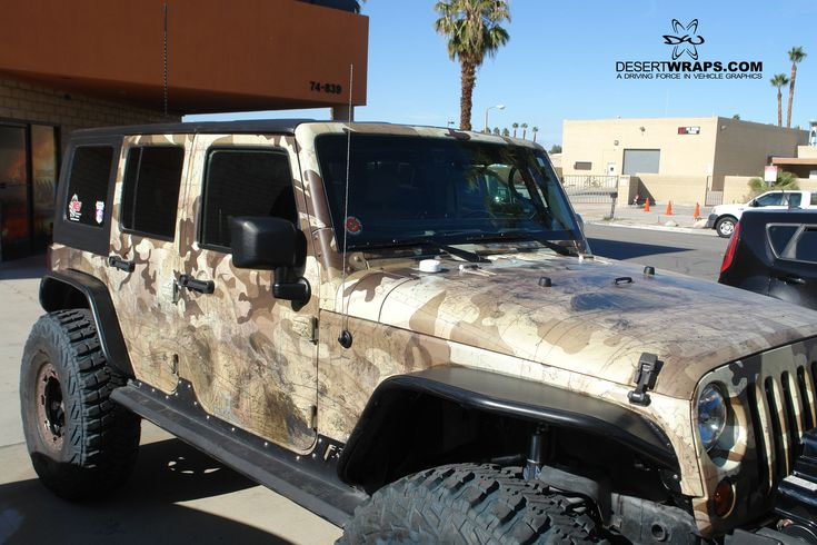 Our vehicle wraps can be customized to any preference. Check out this custom Jeep Wrap we did including a topographic map in the camo.