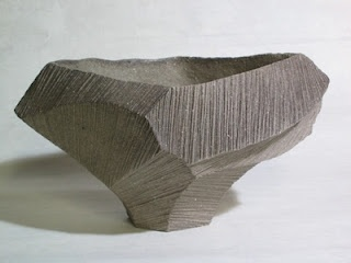 japanese textured ceramic pottery vessel.
