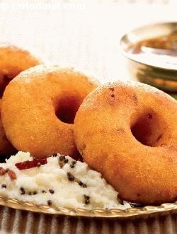 Medu vada is a traditional favourite of south india that features not just in everyday cuisine but is also an indispensable part of the menu on festivals and puja days. Grind the batter with just enough water to make a soft but not watery dough – as it's the consistency of the batter that determines how soft and shapely the vadas turn out, and of course how many compliments you reap! after all, 'medu' means soft, and the wadas must live up to the name. Take care to make the vadas as soon as…