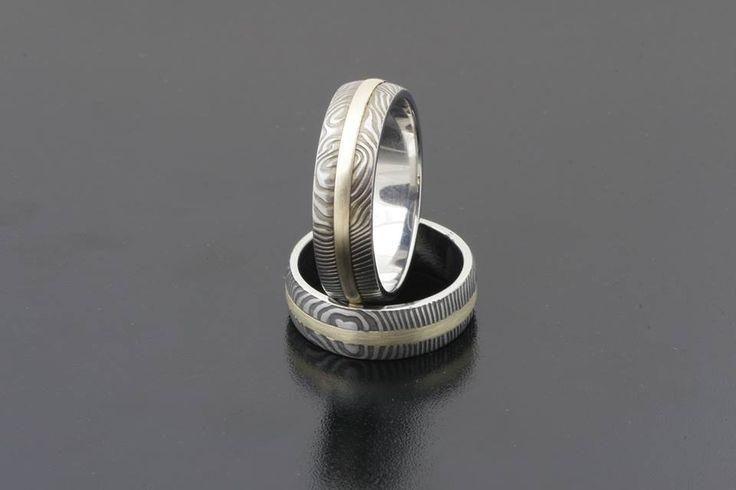 Damasc wedding rings with yellow gold by Bielak. more: weddingringsbybielak.com