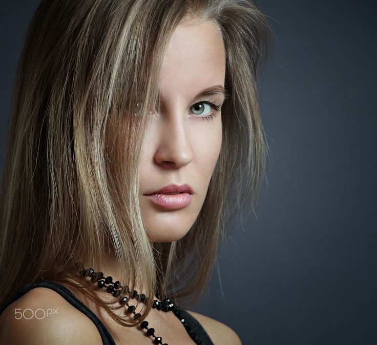 Stylish young woman - Stylish young woman on a gray background