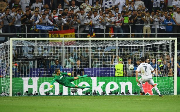 Cristiano Ronaldo of Real Madrid scores the winning penalty in the Champions…