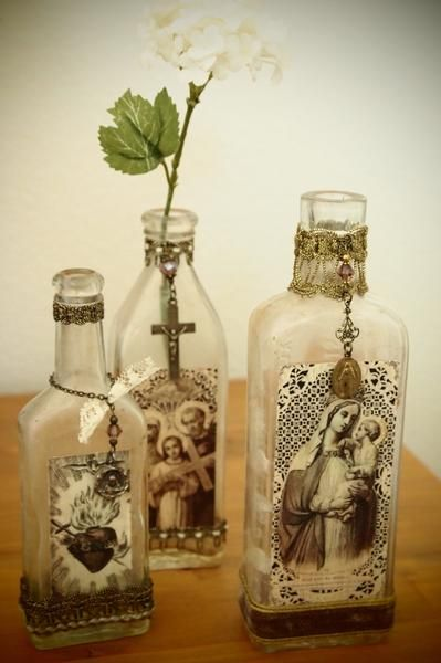 Weathered vintage bottles become set of three pretty Victorian decor bottles!  Each is unique, trimmed in various antique and vintage ribbons, with vintage religious medals