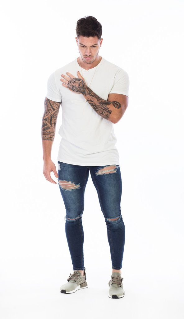 SET IN STONE BLUE DENIM DESTROYED SPRAY ON SKINNY JEANS Our Super Skinny jeans come in a blue denim destroyed wash, tapered right down to the ankle for that per