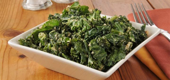 Recipe Alert!! Fast and Simple Kale Salad Recipe! Grind up almonds and half some grapes for toppings and finish with a lemon vinaigrette!