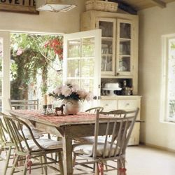 Country kitchen vintage shabby chic style. Love the way sun streams in through the french windows.