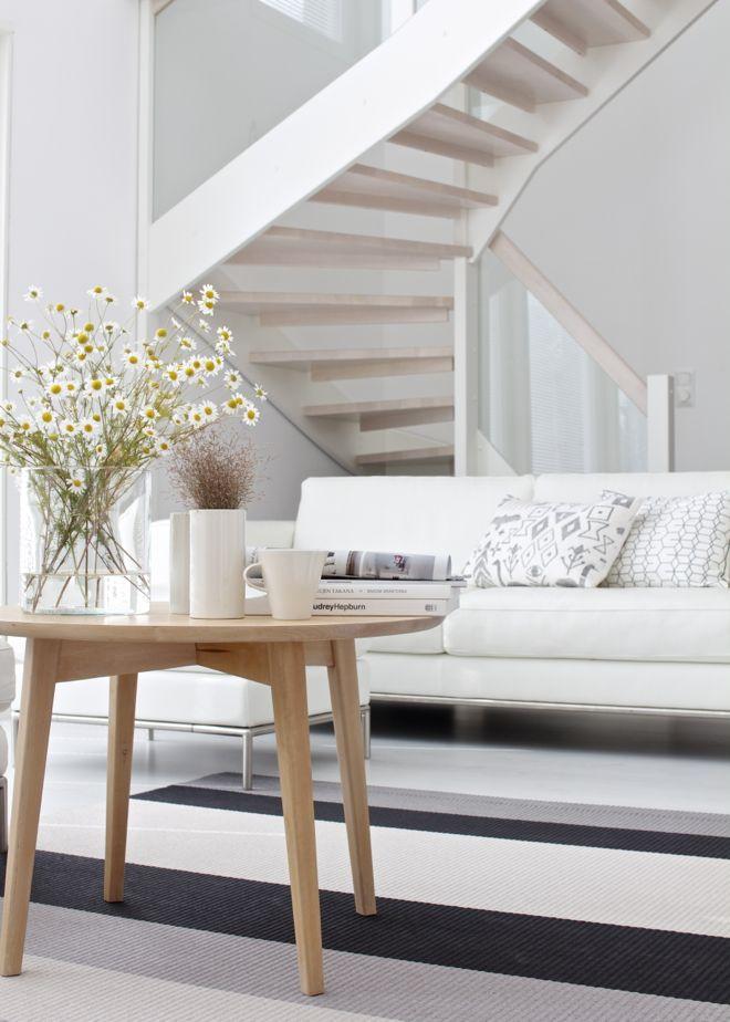 lounge. white. light wood. flowers. lisbet e.
