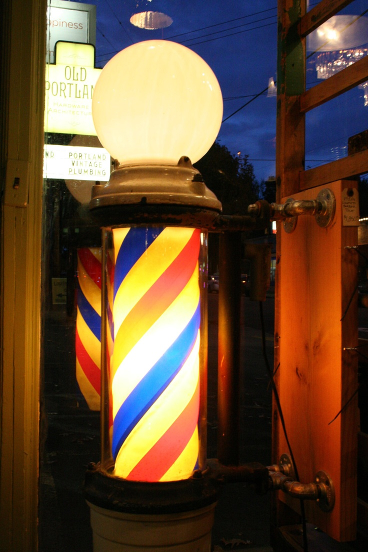 1920s Lighted Barber's Shop Pole with Cast Iron Body - Antique with Original Parts. $1,850.00, via Etsy.