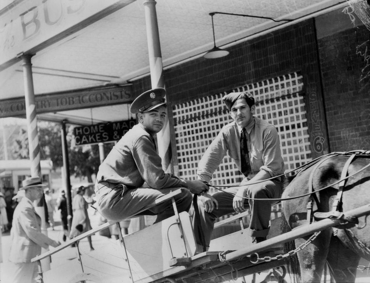 """American soldiers on a delivery cart in Brisbane, Queensland  """"...the trickle of American troops into the city had become a steady flow. Everybody called them 'Yanks', even after it was politely explained that many came from south of the Mason Dixon line."""" John Oxley Library, State Library of Queensland Neg: 105721"""