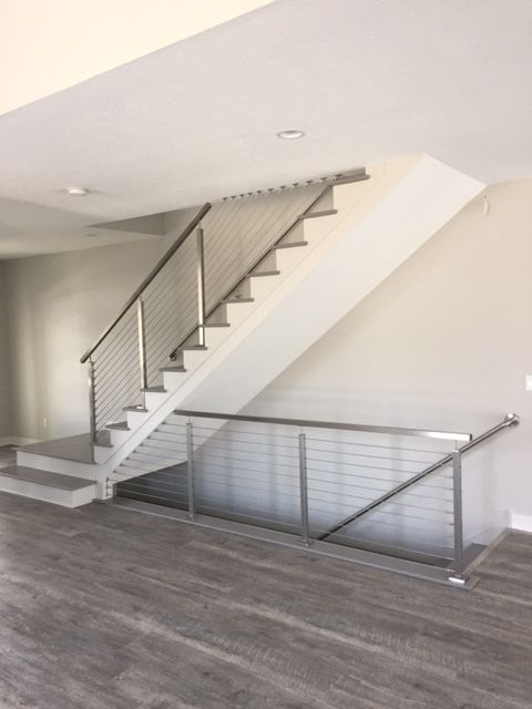 From our friends at Creative Stair Parts, our stainless steel cable railing system in application.