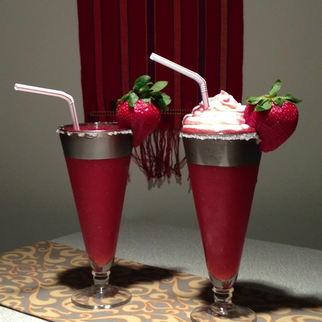 the perfect summer drink... strawberry daiquiris - one with strawberry alcohol infused whipped cream