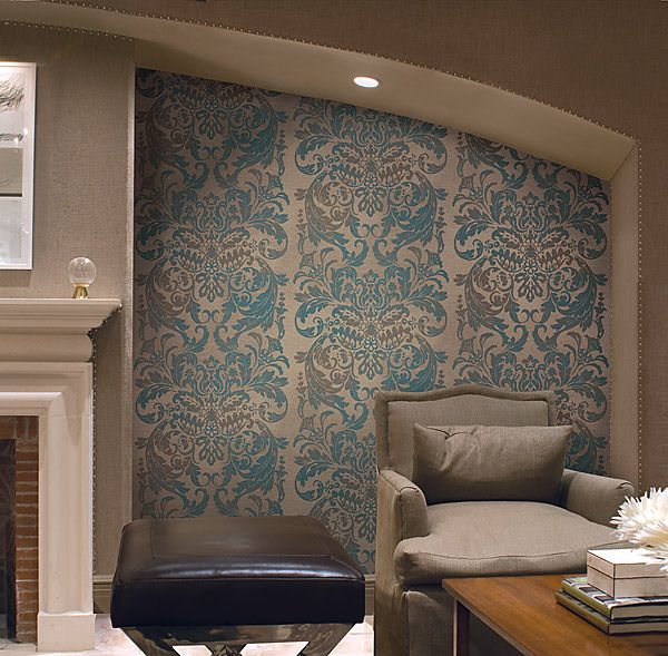 Living Room feature wall with a chic turquoise and charcoal damask stripe wallpaper by Brewster