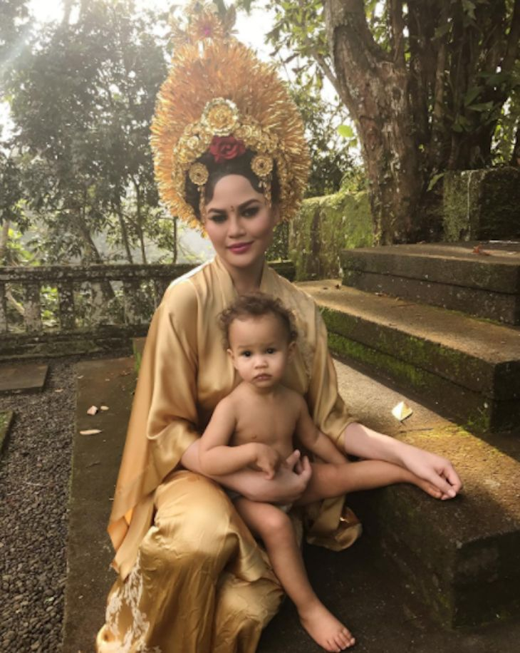Chrissy Teigen proves that you can travel with your child at just about any age. The celebrity mom and model shared a new photo of her and her 15-month-old daughter Luna enjoying their vacation in Bali, Indonesia with husband and father John Legend. Dressed in the local culture's traditional costum