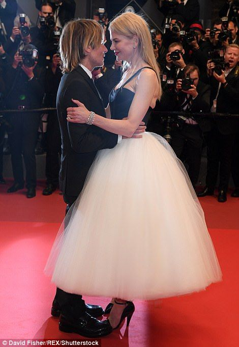 Too much? Nicole Kidman and husband Keith Urban indulged in a sickly sweet PDA at the prem...