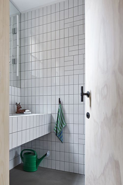 A way to break up the monotony of an all-tile wall.... Studio AR
