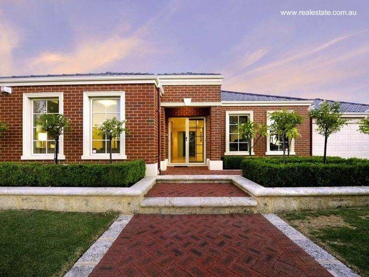 residencia moderna australiana con fachada de ladrillos colorados