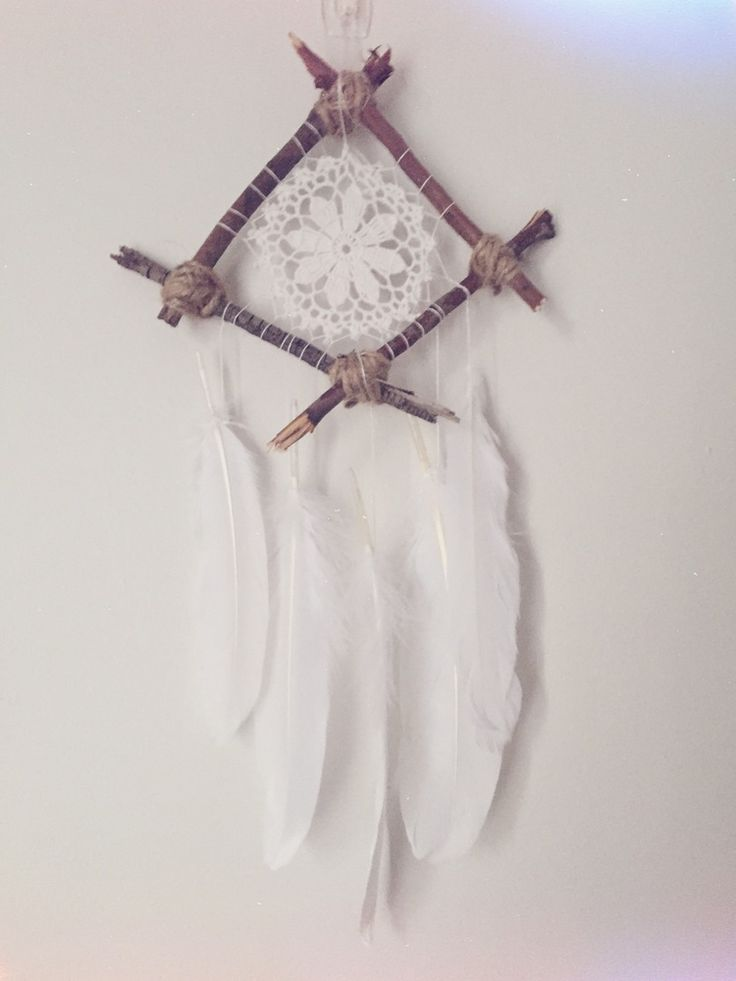 Natural dreamcatcher made of twigs, feathers and a doily centre. http://www.longlostdreams.com.au/product/woodland-boho