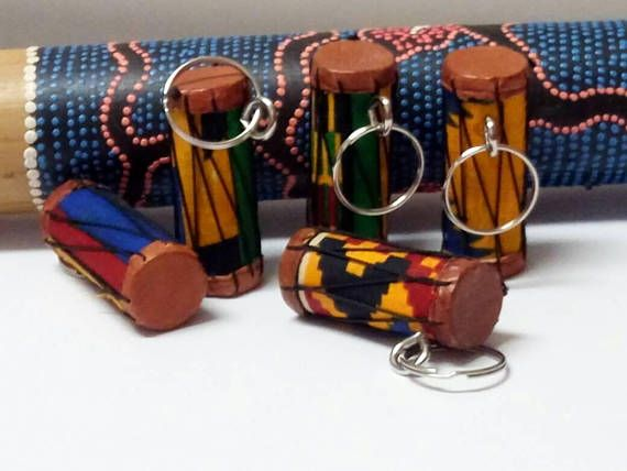 Check out this item in my Etsy shop https://www.etsy.com/uk/listing/560335026/african-kente-drum-keychains-and