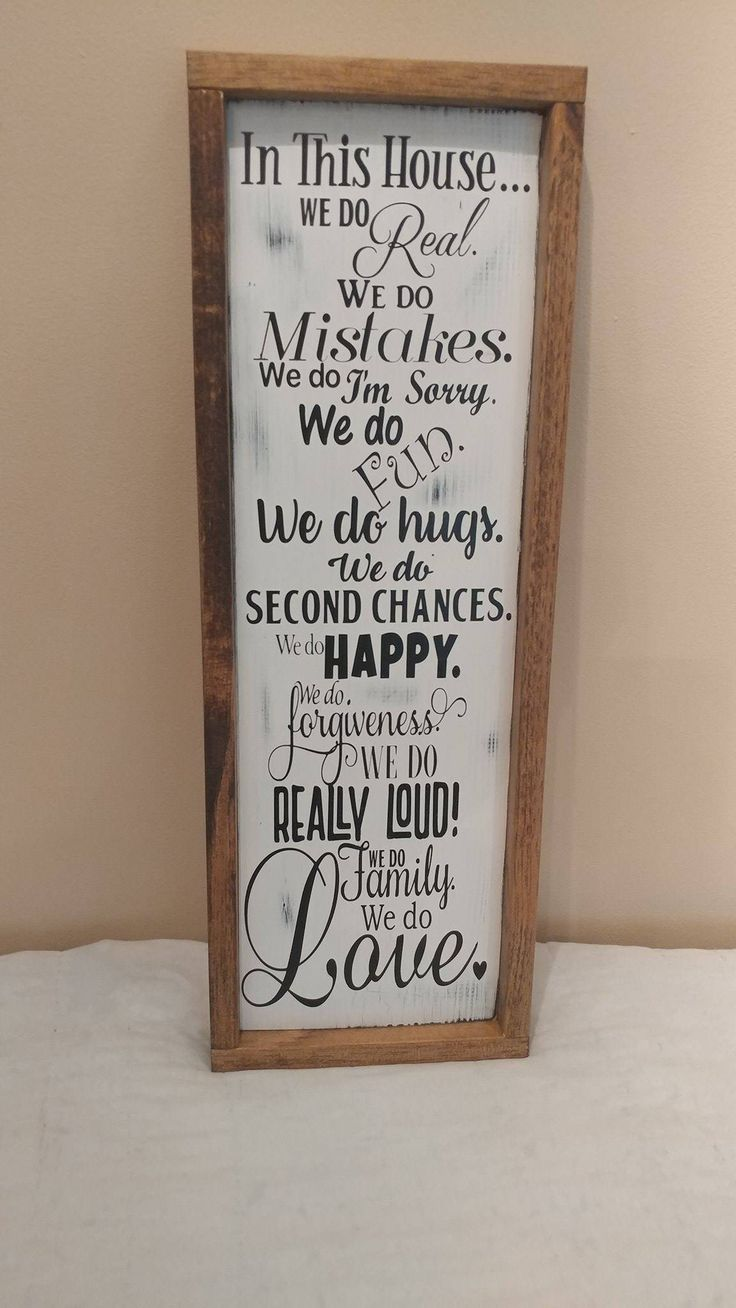 In this house we do wood framed sign Vertical wood family rules sign in that farmhouse, fixer upper style that Joanna Gaines has made so popular. Framed for that rustic decor look. Perfect housewarmin