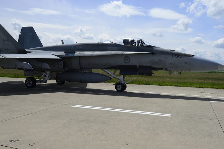 """Tail Number (788): Lieutenant-Colonel Darcy """"Plug"""" Molstad, Canadian Air Task Force Commander, taxis a CF-18 Hornet fighter jet on the runway in Câmpia Turzii, Romania to prepare for a familiarization flight of the region during NATO reassurance measures on May 12, 2014.   Photo by MCpl Patrick Blanchard, Canadian Forces Combat Camera (IS2014-3022-17)"""