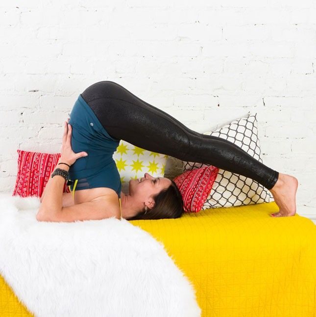 6 Lazy Girl Yoga Poses You Can Do Without Leaving Your Bed | Brit + Co