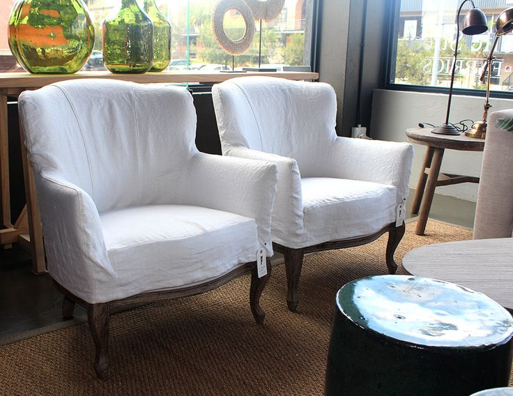 loose linen covered chairs