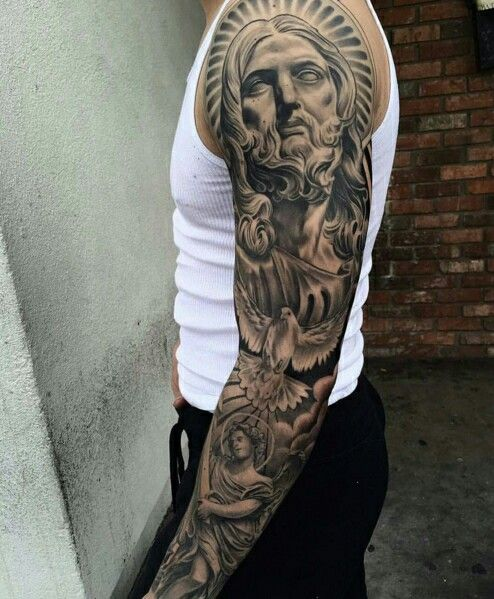 25 best ideas about religious tattoos for men on for Christian tattoo shop