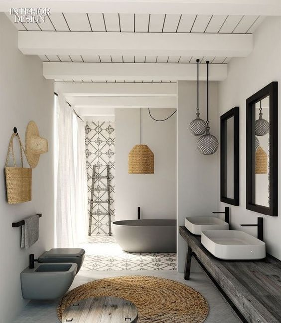 Lovely light filled white-washed bathroom with soft natural accents, woven mat, large pendant lights, simple details