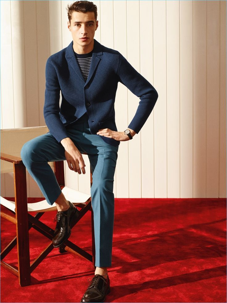 Model Adrien Sahores is chic in a knit blazer and slim pleated trousers from De Fursac.