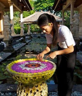 Arranging the frangipani flower petal. Photo taken at Matahari Beach Resort & Spa, Bali Indonesia
