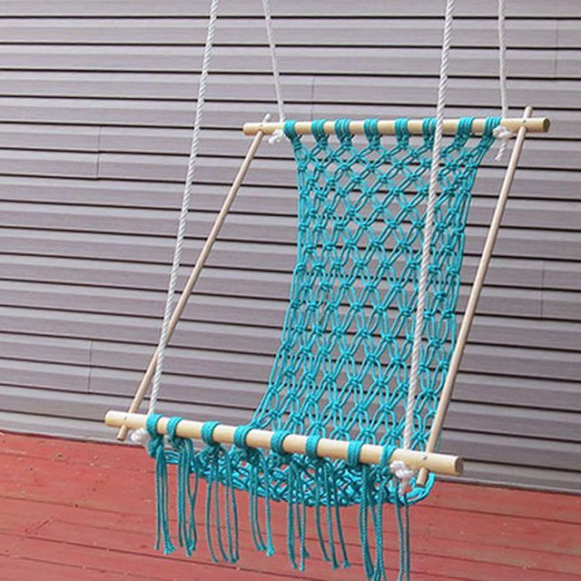 Relax on your porch in a comfortable macrame hammock.