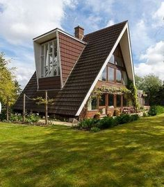 a sixties canadian a frame house in kent with a wraparound garden for - Unusual Home Designs