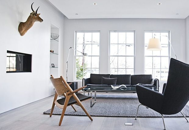 Nordic and minimalistic living room featuring the Wing Chair by Hans J. Wegner. Danish design.