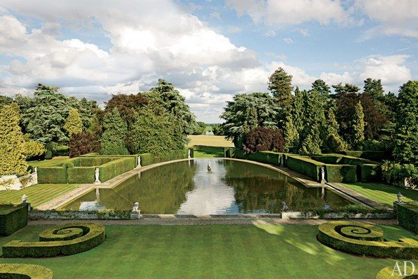 The vista from a second-floor window takes in an ornamental pool ringed by clipped hedges and, in the distance, an 800-yard-long canal. Reportedly designed in the late 17th century by Sir Christopher Wren, the redbrick wing houses Max's design studio.