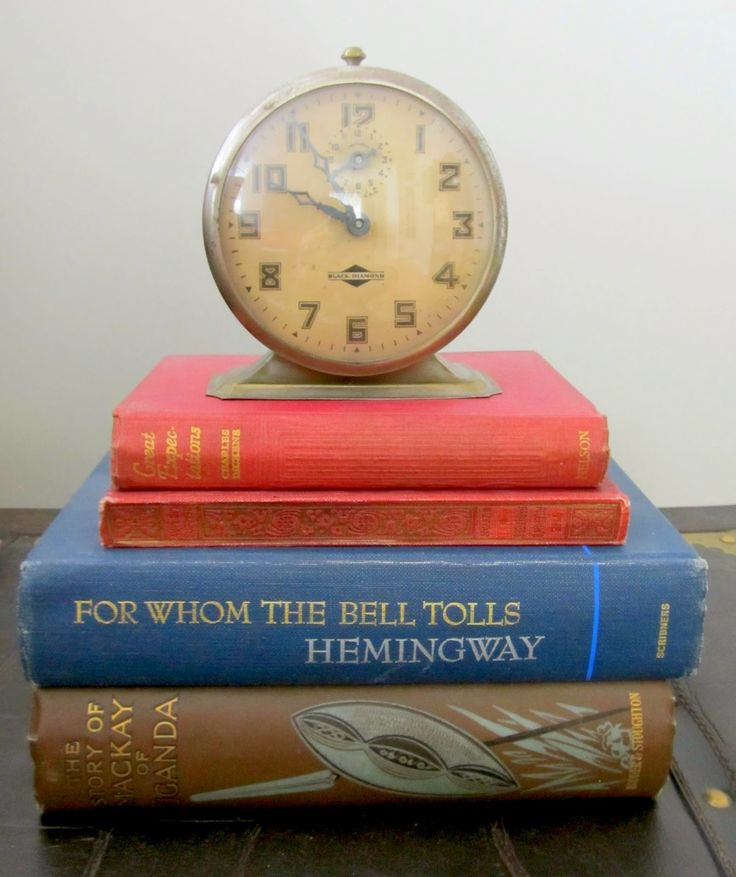 How to Add Vintage Elements to Your Home - vintage books and vintage clock