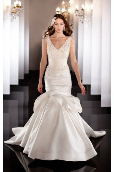 This fit-and-flare designer bridal gown features an asymmetrically ruched bodice and dropped waist finishing with a dramatic flared skirt.  Lace up or zip up back. Venice lace jacket sold separately.  Grosgrain ribbon sash sold separately.